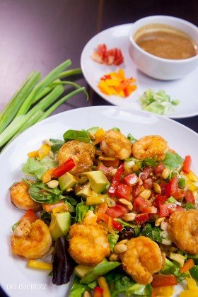 Shrimp avocado salad, a wonderfully satisfying main course salad. Crunchy, sweet, sour and nutty. This colorful salad explodes with flavors and textures. At the same time, it brings together luscious greens, sweet peppers, scallions, peanuts and creamy avocados with a perfectly crafted dressing. www.delishbuzz.com