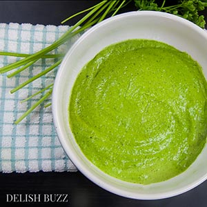 Vegan pesto is creamy rich and is completely vegan :) This simple pesto is made from fresh parsley and raw cashews. Vegan cashew pesto is so versatile that it can be used in many things beyond pastas. It has the yummy deep richness of greens and zesty aromas of fresh herb - www.delishbuzz.com