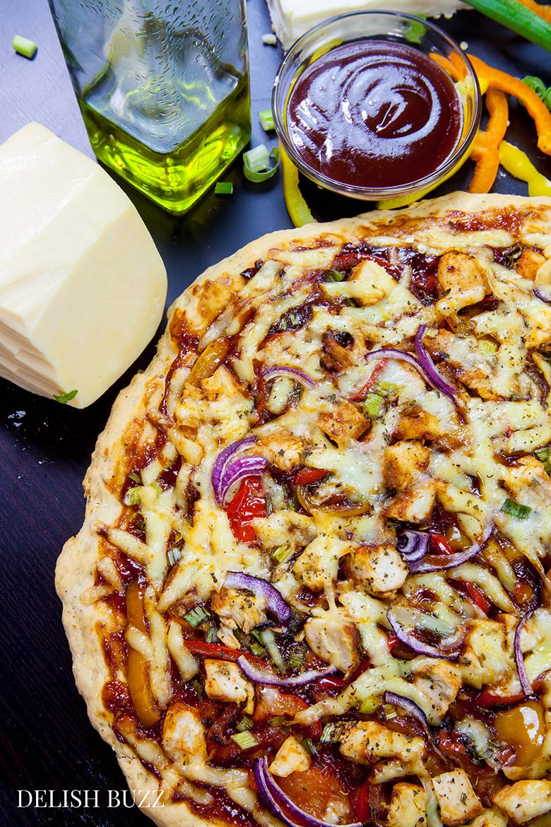 Smoked Gouda and smoked paprika do wonders here! Easy Barbeque Chicken Pizza explodes with flavors in your mouth. Instant no rise homemade crust along with barbeque sauce, sweet peppers and gouda cheese makes this pizza irresistible. www.delishbuzz.com