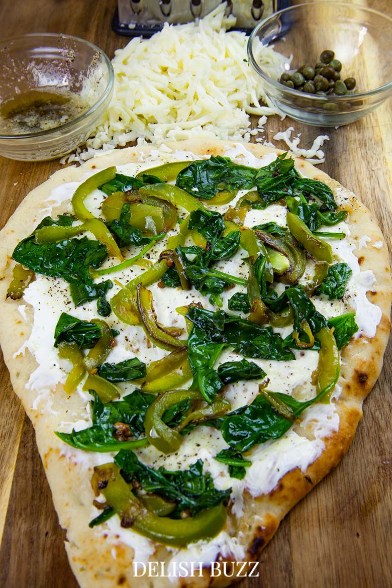 We love the colors here. Prep work is so easy for this flatbread pizza. Basil butter naan white pizza is as good as artisan pizzas. This recipe will make you realize how easy it is whip up a delicious flatbread pizza at home. - www.delishbuzz.com