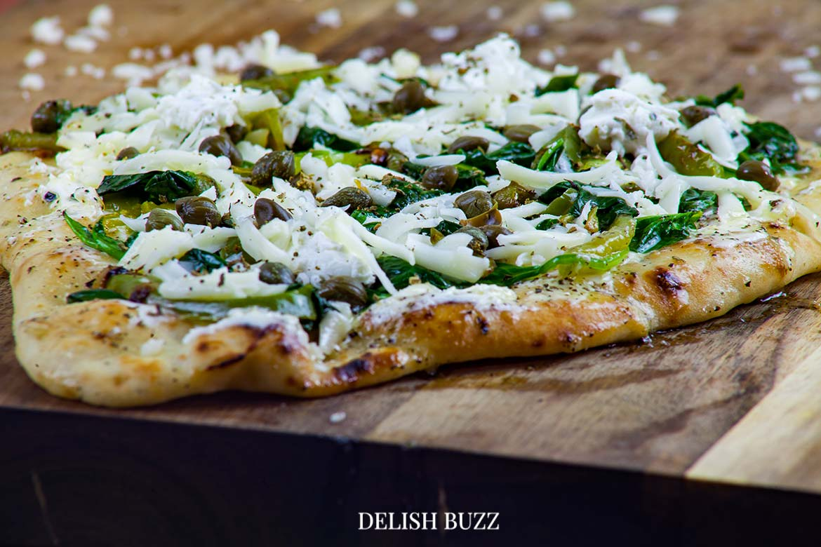 The smell of basil butter and crushed oregano fill the air. Basil butter naan white pizza is as good as artisan pizzas. This recipe will make you realize how easy it is whip up a delicious flatbread pizza at home. - www.delishbuzz.com
