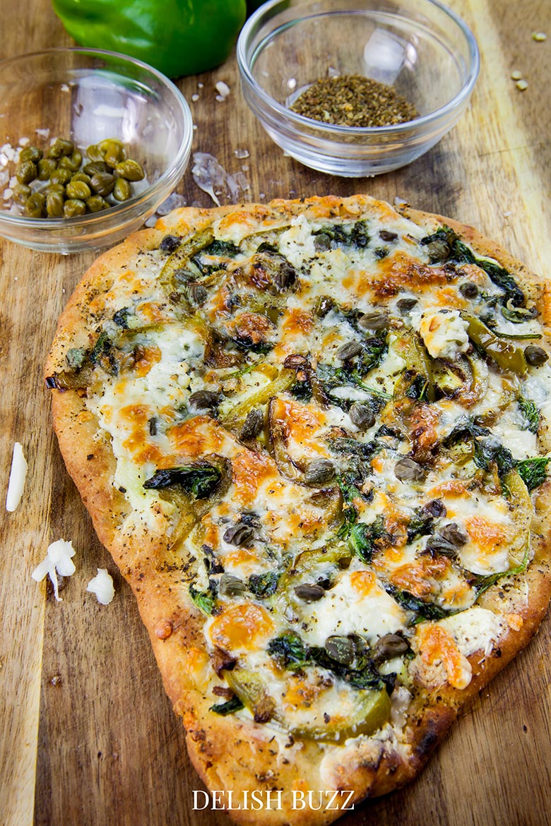I want this now! Perfect colors and aroma when this pizza is done! Basil butter naan white pizza is as good as artisan pizzas. This recipe will make you realize how easy it is whip up a delicious flatbread pizza at home. - www.delishbuzz.com